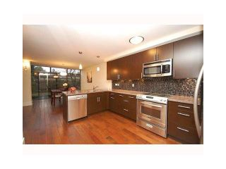 """Photo 2: 112 4101 YEW Street in Vancouver: Quilchena Condo for sale in """"ARBUTUS VILLAGE"""" (Vancouver West)  : MLS®# V1118853"""