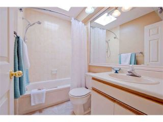 """Photo 18: 125 2721 ATLIN Place in Coquitlam: Coquitlam East Townhouse for sale in """"THE TERRACES"""" : MLS®# V1057013"""