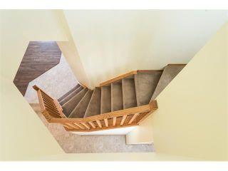 Photo 10: 223 CRYSTALRIDGE Place: Okotoks House for sale : MLS®# C4091900