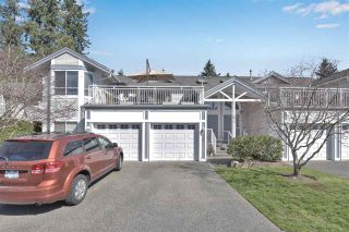 "Photo 1: 205 9072 FLEETWOOD Way in Surrey: Fleetwood Tynehead Townhouse for sale in ""WYND RIDGE"" : MLS®# R2567769"