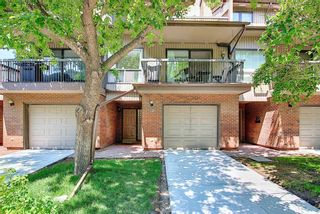 Main Photo: 14 Point Mckay Crescent NW in Calgary: Point McKay Row/Townhouse for sale : MLS®# A1130128
