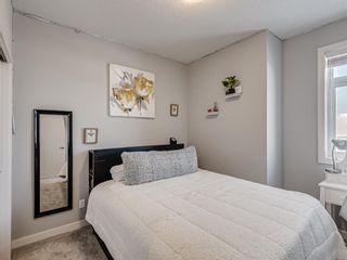 Photo 33: 199 Silverado Plains Park SW in Calgary: Silverado Row/Townhouse for sale : MLS®# A1079562