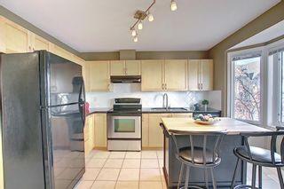 Photo 3: 108 Cedarwood Lane SW in Calgary: Cedarbrae Row/Townhouse for sale : MLS®# A1095683