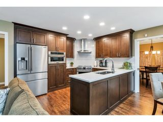 """Photo 9: 118 6109 W BOUNDARY Drive in Surrey: Panorama Ridge Townhouse for sale in """"LAKEWOOD GARDENS"""" : MLS®# R2625696"""