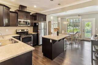 """Photo 1: 26 45025 WOLFE Road in Chilliwack: Chilliwack W Young-Well Townhouse for sale in """"Centre Field"""" : MLS®# R2576218"""