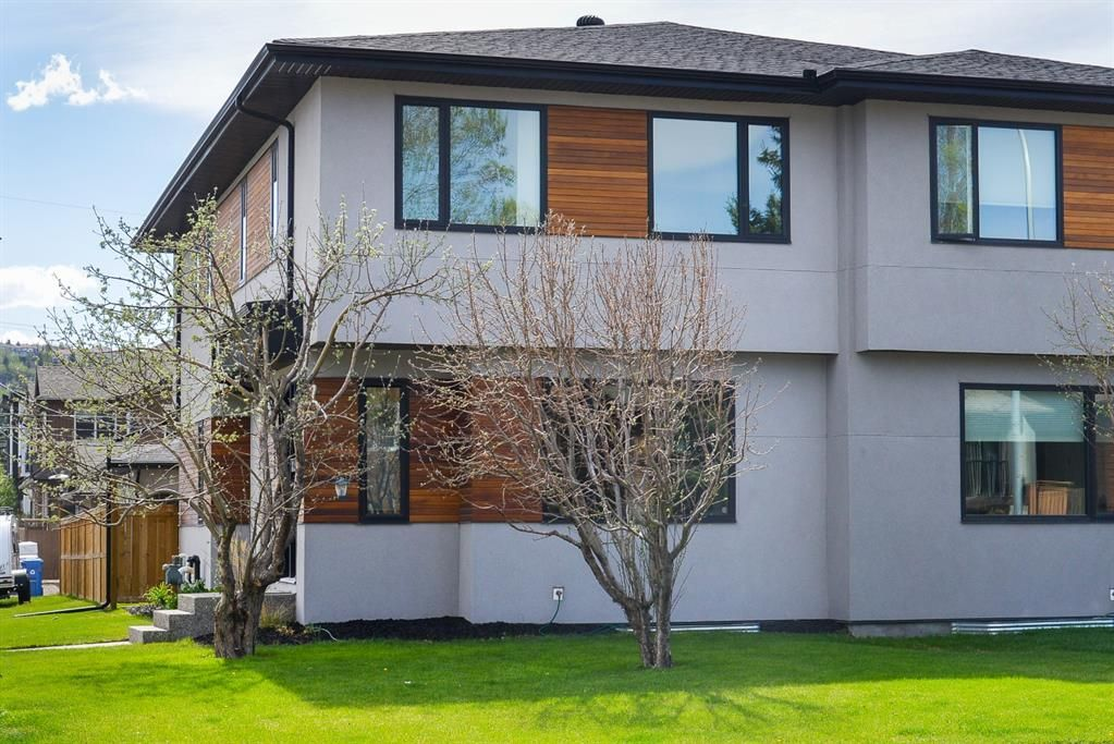 Main Photo: 1951 47 Street NW in Calgary: Montgomery Semi Detached for sale : MLS®# A1104342