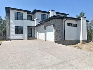 Main Photo: 31 Rockford Park NW in Calgary: Rocky Ridge Detached for sale : MLS®# A1116840