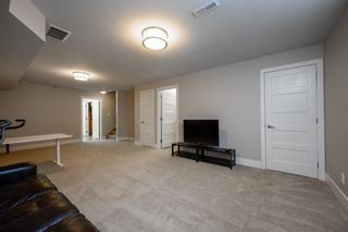Photo 30: 524 Quarry Park Boulevard SE in Calgary: Douglasdale/Glen Row/Townhouse for sale : MLS®# A1084098