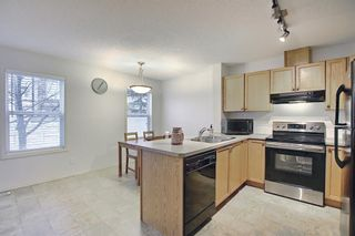 Photo 11: 4 Panatella Street NW in Calgary: Panorama Hills Row/Townhouse for sale : MLS®# A1082560