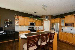 Photo 5: 12 BOW RIDGE Drive: Cochrane House for sale : MLS®# C4129947