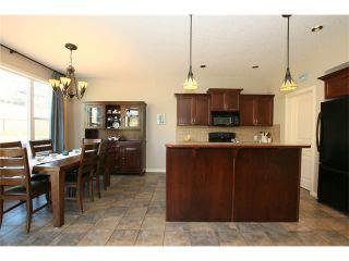 Photo 9: 188 SUNSET Close: Cochrane House for sale : MLS®# C4115906