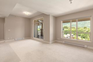 """Photo 2: 603 1211 VILLAGE GREEN Way in Squamish: Downtown SQ Condo for sale in """"ROCKCLIFF"""" : MLS®# R2573545"""