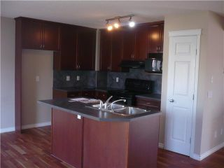 Photo 4: 129 COUGAR PLATEAU Mews SW in CALGARY: Cougar Ridge Residential Detached Single Family for sale (Calgary)  : MLS®# C3531581