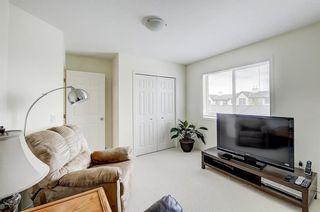 Photo 16: 3 EVERRIDGE Villa SW in Calgary: Evergreen Semi Detached for sale : MLS®# C4297700