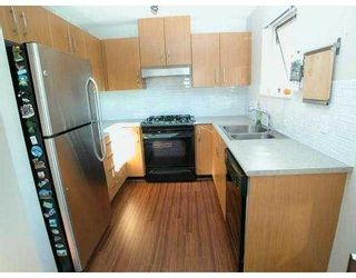 """Photo 7: 500 KLAHANIE Drive in Port Moody: Port Moody Centre Condo for sale in """"THE TIDES"""" : MLS®# V635966"""