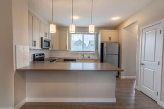 Photo 8: 48 Carringvue Link NW in Calgary: Carrington Semi Detached for sale : MLS®# A1111078