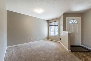 Photo 5: 50 New Brighton Close SE in Calgary: New Brighton Detached for sale : MLS®# A1100086