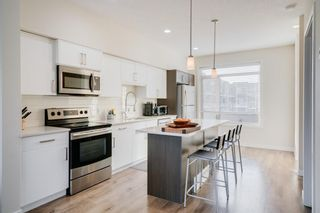 Main Photo: 8 Westpark Common SW in Calgary: West Springs Row/Townhouse for sale : MLS®# A1145452