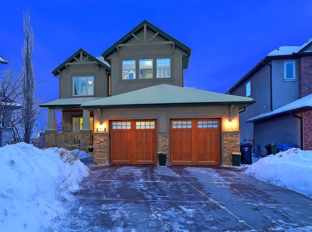 Gorgeous curb appeal, solid wood garage doors and a copper patina door lead you into your castle.