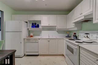 """Photo 29: 311 15272 20 Avenue in Surrey: King George Corridor Condo for sale in """"Windsor Court"""" (South Surrey White Rock)  : MLS®# R2582826"""
