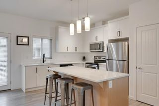 Photo 2: 416 LEGACY Point SE in Calgary: Legacy Row/Townhouse for sale : MLS®# A1062211
