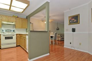 "Photo 6: 101 33030 GEORGE FERGUSON Way in Abbotsford: Central Abbotsford Condo for sale in ""Carlise"" : MLS®# F1446817"