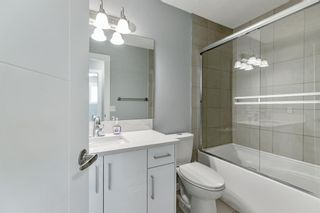 Photo 18: 23 Erin Meadows Court SE in Calgary: Erin Woods Detached for sale : MLS®# A1146245