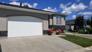 Photo 1: 72 Elysian Crescent SW in Calgary: Springbank Hill Semi Detached for sale : MLS®# A1148526