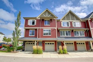 Photo 2: 1103 125 Panatella Way NW in Calgary: Panorama Hills Row/Townhouse for sale : MLS®# A1143179