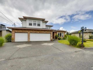 Photo 1: 1124 DANSEY Avenue in Coquitlam: Central Coquitlam House for sale : MLS®# R2589636