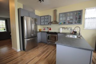 """Photo 5: 18486 65 Avenue in Surrey: Cloverdale BC House for sale in """"Clover Valley Station"""" (Cloverdale)  : MLS®# R2201415"""