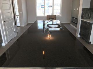 Photo 21: 23 Sunrise Heights: Cochrane Duplex for sale : MLS®# A1017998