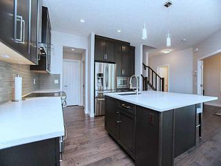 Photo 5: 55 SUNSET Parkway: Cochrane House for sale : MLS®# C3651244