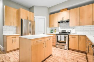 Photo 4: 2 1627 27 Avenue SW in Calgary: South Calgary Row/Townhouse for sale : MLS®# A1106108