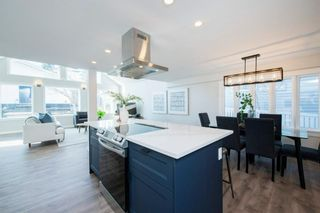 Photo 1: 135 25 Avenue NW in Calgary: Tuxedo Park Detached for sale : MLS®# A1094947