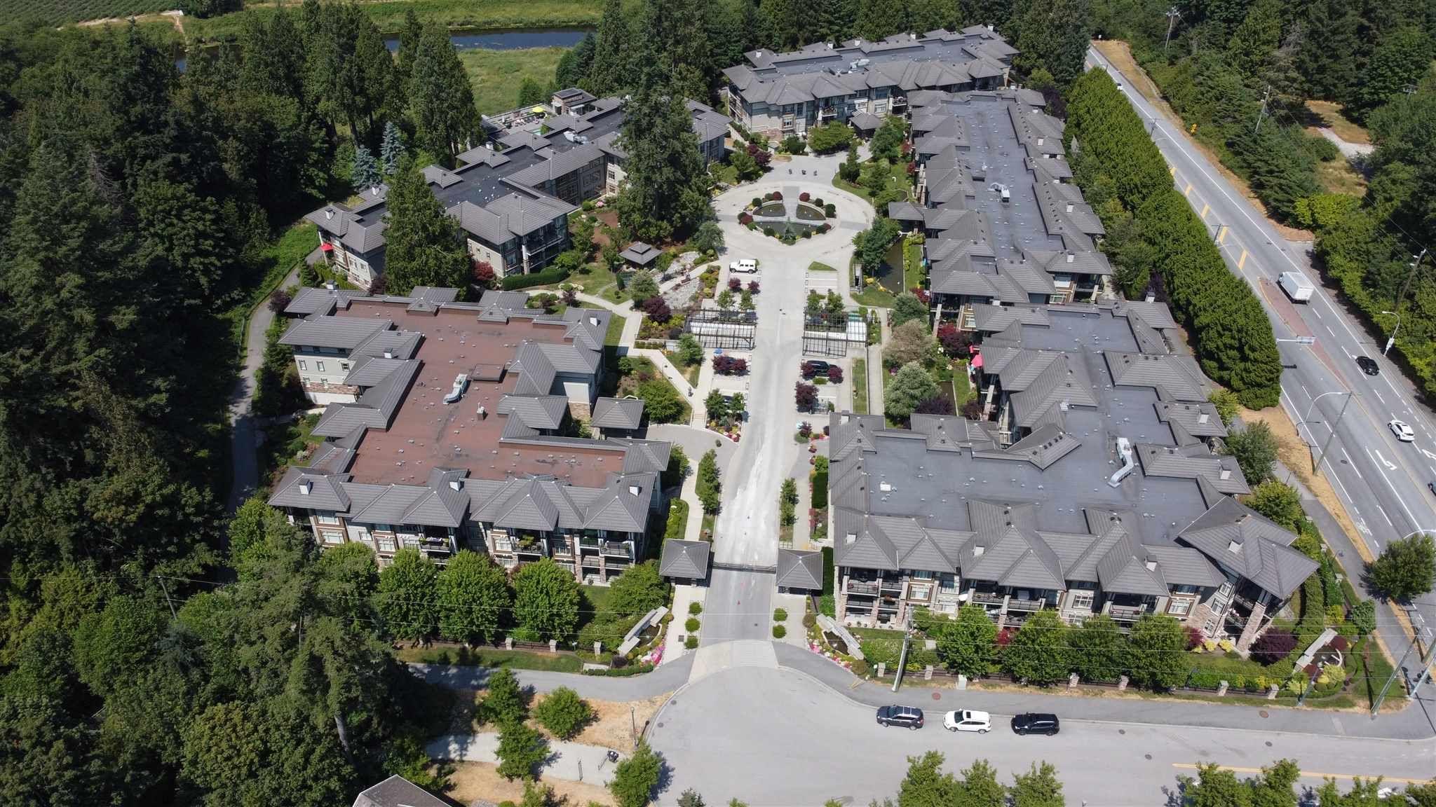 "Main Photo: 202 15195 36 Avenue in Surrey: Morgan Creek Condo for sale in ""Edgewater"" (South Surrey White Rock)  : MLS®# R2600420"