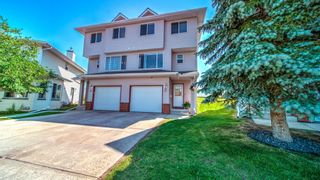 Main Photo: 19 Harvest Oak Circle NE in Calgary: Harvest Hills Row/Townhouse for sale : MLS®# A1129159