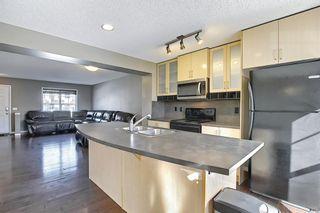 Photo 6: 3326 New Brighton Gardens SE in Calgary: New Brighton Row/Townhouse for sale : MLS®# A1077615