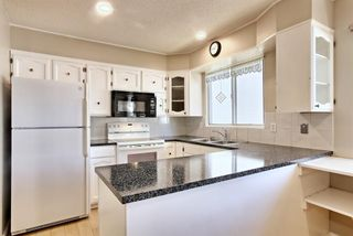 Photo 11: 5320 Silverdale Drive NW in Calgary: Silver Springs Detached for sale : MLS®# A1092393