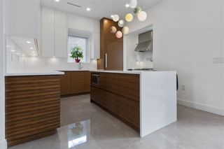 Photo 10: 2620 ADANAC Street in Vancouver: Renfrew VE House for sale (Vancouver East)  : MLS®# R2584945