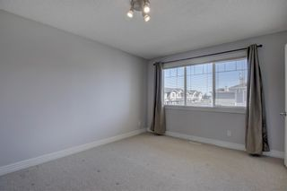 Photo 14: 76 Bridleridge Manor SW in Calgary: Bridlewood Row/Townhouse for sale : MLS®# A1106883
