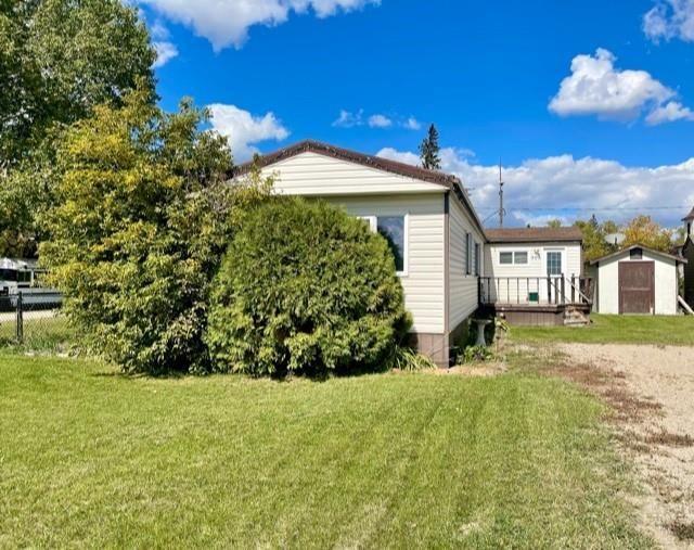Main Photo: 305 Church Avenue in Miniota: R32 Residential for sale (R32 - Yellowhead)  : MLS®# 202122850