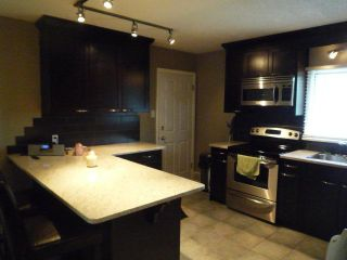 Photo 2: 132 41 Avenue NW in CALGARY: Highland Park Residential Detached Single Family for sale (Calgary)  : MLS®# C3537411