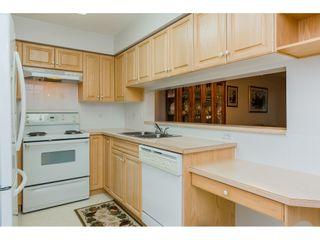 "Photo 9: 322 13880 70 Avenue in Surrey: East Newton Condo for sale in ""Chelsea Gardens"" : MLS®# R2348345"