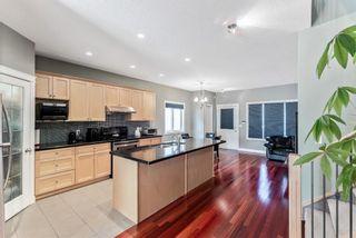 Photo 7: 702 69 Avenue SW in Calgary: Kingsland Semi Detached for sale : MLS®# A1081661