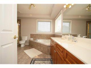 Photo 35: 147 CRAWFORD Drive: Cochrane Condo for sale : MLS®# C4028154