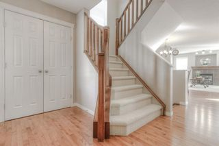 Photo 4: 105 Bridleridge View SW in Calgary: Bridlewood Detached for sale : MLS®# A1090034
