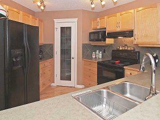 Photo 5: 215 EVANSMEADE Common NW in CALGARY: Evanston Residential Detached Single Family for sale (Calgary)  : MLS®# C3554282