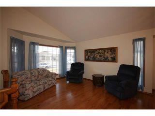 Photo 5: 31 RIVERVIEW Close: Cochrane House for sale : MLS®# C4055630