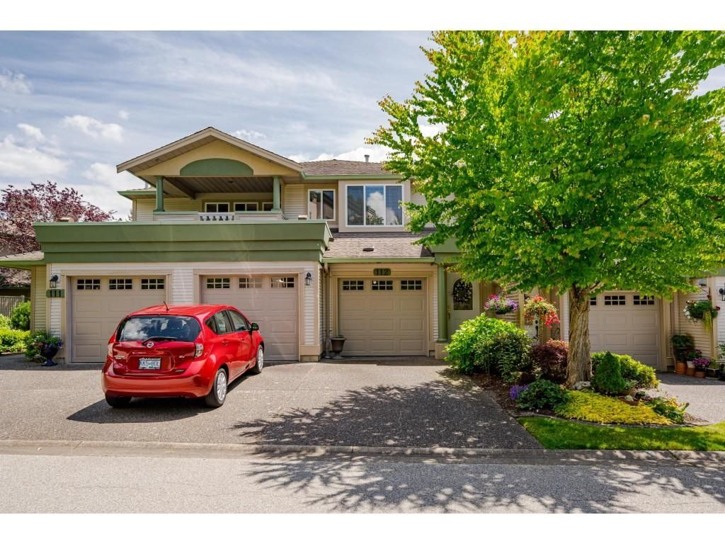 """Main Photo: 112 13888 70 Avenue in Surrey: East Newton Townhouse for sale in """"Chelsea Gardens"""" : MLS®# R2594142"""
